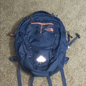 The North face blue and pink backpack.